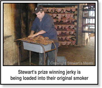 Stewart's prize winning jerky is being loaded into their original smoker